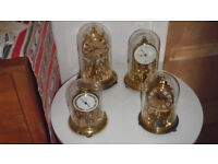 Four anniversary clocks spare or repairs