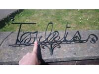 Reclaimed Wrought Iron Toilets Sign