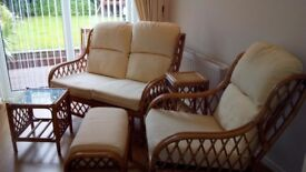 Cane sofa, chair, side table set.