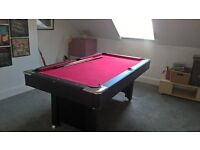 6ft x 3.5ft pool table in good condition with cues and balls.