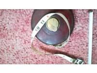 Retro leather bound measuring tape.