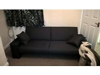 brand new dark grey two seater sofa bed.