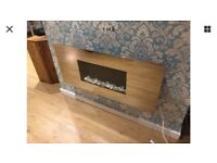 Celsi wall mounted electric fire with remote control .