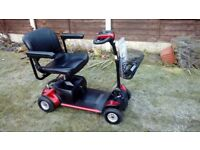 PRIDE GOGO ELITE TRAVELLER PLUS MOBILITY SCOOTER 4MPH LOTS SPENT ON IT LOVELY CONDITION TAKES APART
