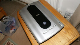 Canonscan Scanner. Will scan photos,slides, negatives and documents in excellent definition.