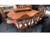 ornately carved lovely extending dining table with 6 chairs