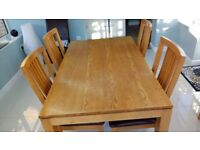 Oak dining table and 4 oak/leather chairs