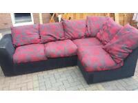red/black fabric corner sofa in excellent condition