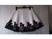 Cream/black lace short skirt