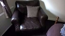 Two brown Leather chairs for sale will sell separately £30 each