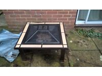 Fire pit/bbq grill with cream tiles