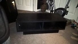 Black TV unit. 2 spaces for consoles or sky boxetc. £20