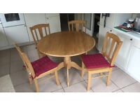 Solid wood round table and four chairs