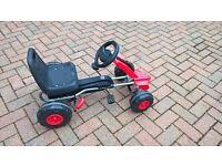 Child's pedal go kart.