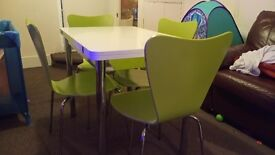 Table and chairs... Extendable