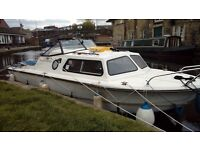 Norman 20 Canal/River Cruiser.Yamaha 9-9+new 6hp aux.Boat in use,and ready to go.