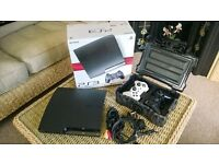 PS3 Slim 120GB in immaculate condition, 2 x DualShock3 Sixaxis controllers & charging box