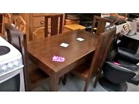 good quality dark wood dining table and 4 high back chairs for 75 pounds