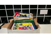 box of assorted football programmes