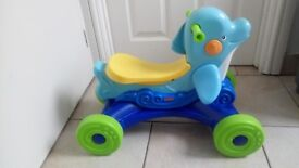 Fisher price musical dolphin ride along