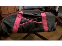 Pink and grey Ladies gym bag with separate trainer section.