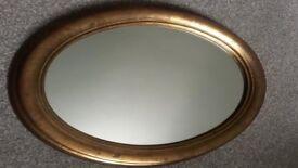 Oval mirror, gilt frame,