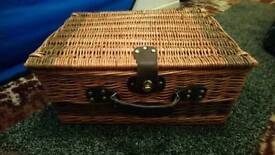 Picnic basket with cutlery and glasses