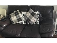Three seater and two seater brown leather sofas