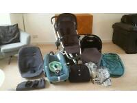 Quinny Buzz Travel System in unisex Emerald Green and Rocking Black.