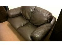 2 x two seater brown leather sofas, no longer needed, well used but clean and comfy