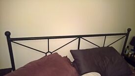 Cast Iron and Wood Bed Frame for sale!
