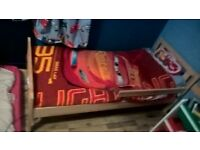 Boys toddler bed with mattress in immaculate condition