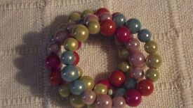 Disco/miracle beads, bracelets, anklets and necklaces.
