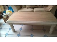 solid oak coffee table, attractive. oblong in shape with waxed wooden solid surface.