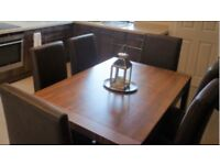 Extendable Solid brown dining table with chairs