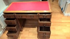 Traditional Solid Desk with 4 foot x 2 foot Top Surface and 8 drawers.