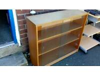 Bookcase with glass sliding doors