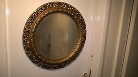 Large round ornate mirror