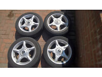 "Mini Cooper 16"" Alloy Wheels with Worn Tyres"