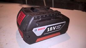 Two Bosch 18v 3.0Ah Li-Ion batteries and one AL 1820 cv charger
