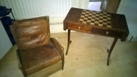 An old oak chair and a chess / games table