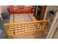 Pine double bed with comfortable mattress, barely used.