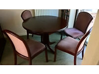 Dining room table and 4 chairs (dark wood). Good condition