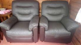 2 brown leather armchairs