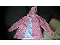 Pretty Pink Hatley Girls Raincoat with horses size 7 years as new