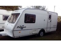 2003 caravan in good condition with porch awning and extras
