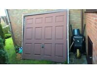 Garage door and frame for sale - good condition.