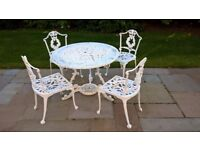 White metal outdoor dining table and 4 chairs