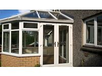 white UPVC conservatory and french doors