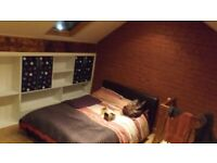 Rooms to rent in a terraced house near city centre